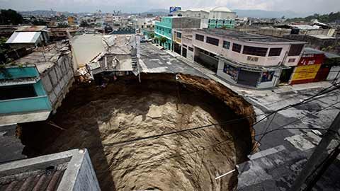 2010 Guatemala City sinkhole that measured 65 feet across and approximately 100 feet deep.